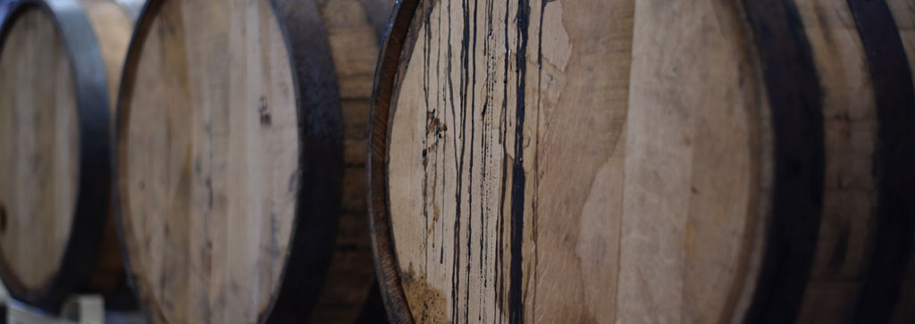 pignolo wine ages in wooden barrels